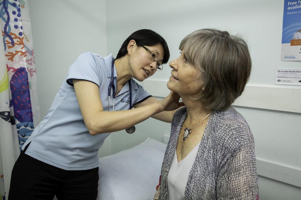 Doctor performing skin checks