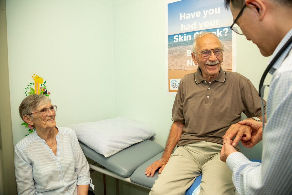 Doctor performing checks on an elderly patient